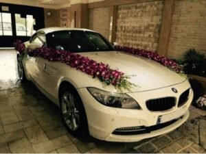 قیمت گل آرایی گل کاری ماشین خودرو عروس در محل شیراز   گل کاری و گل آرایی ماشین عروس شیراز در محل