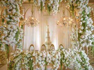 گل آرایی گل کاری باغ تالارها سالنهایی پذیزایی عروسی هرمزگان بندرعباس   قیمت گل آرایی مراسم مجالس عروسی تولد بندرعباس
